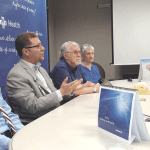 From left, Dr. Octavian Adam, Dr. Mohamad Khaled, and Paul and Kathie Schafer discuss the results of Paul's recent DBS treatment at a recent press conference.