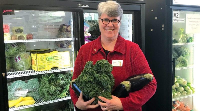 Heidi Nortonsmith displays some of the fresh produce