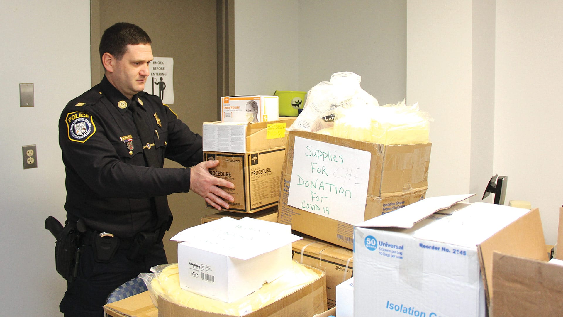 HCC Police Captain Dale Brown stacks boxes
