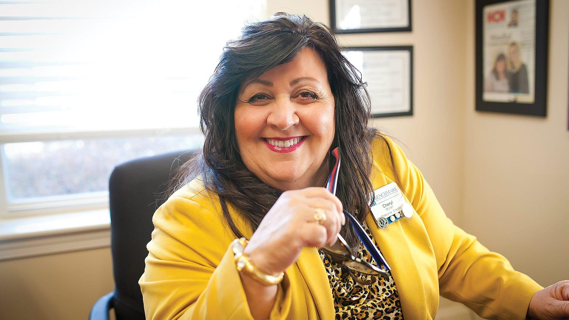 Cheryl Moran says she increased staffers' hours