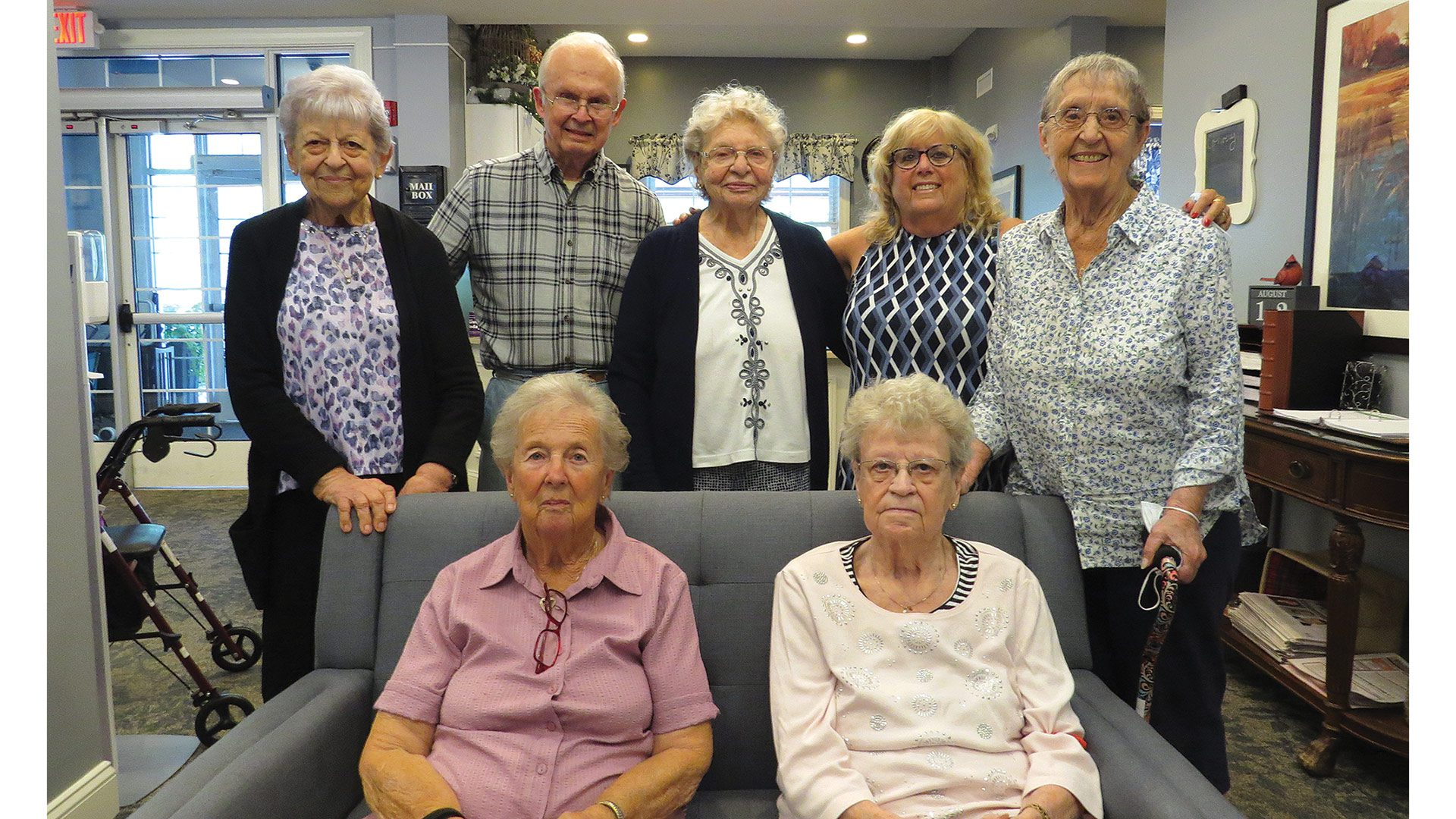 Beth Cardillo, seen here with several residents of Armbrook Village